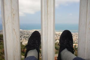 Feet hovering over the port at Haifa in Israel